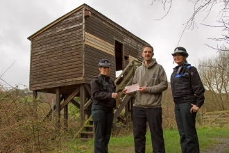 Dyfed Powys Police present cheque for Pwll Penarth to MWT's Rob Haigh copyright MWT