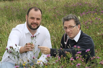 Hilltop Honey owner Scott Davies (left) with MWT's CEO Clive Faulkner at one of the nature reserve hives