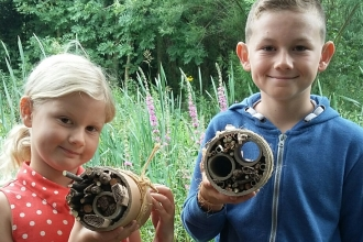 Children making bug homes
