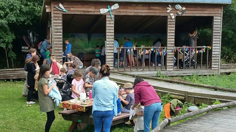 People enjoying an event at Severn Farm Pond copyright Montgomeryshire Wildlife Trust