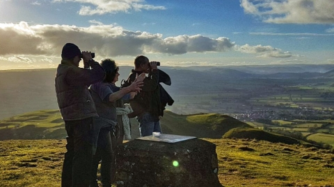 People enjoying the view from Roundton Hill summit copyright MWT