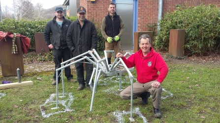Art Oasis project metal spider sculpture being installed in Newtown copyright Montgomeryshire Wildlife Trust